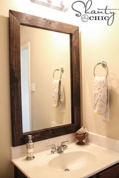 DIY-Mirror-Frame. This is a great idea, although (not being handy with saws and such) I would cheat and start with a wooden frame that's already made, assuming I could find one the right size and color. The secret is in the way the frame is hung over the unframed bathroom mirror.