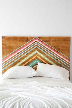Fun idea for a headboard w/reclaimed wood (this one $700/Urban Outfitters). Could paint horizontal stripes, also.