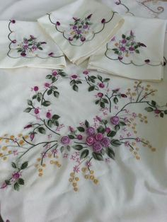 Embroidered linens ...even paper plates feel elegant on this...