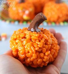 These Adorable Pumpkin Rice Krispies Treats are a fun project the whole family can enjoy doing together. Don't eat them all at once. Save some for the party!