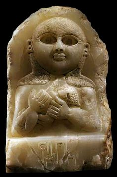 Sabean Alabaster Stele Depicting a Mother and Child, Yemen, Circa: 200 BC to 100 AD