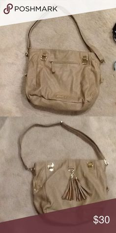 Steve Madden Tote Tan Steve Madden tote with exterior zipper and fringe tassels as well as exterior side zippers and Steve Madden label on the bottom middle of the bag. The inner consist of a large pouch on the side and a smaller pouch next to it and on the opposing side of the bag there is a zippered pouch. Although, there is a minor tear which is hard to see unless shown extremely closely in the interior of the bag. Steve Madden Bags Totes