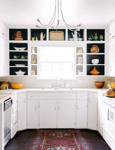 We love this simple white #kitchen with all the open shelving. What do you guys think? www.budgetbathandkitchen.com