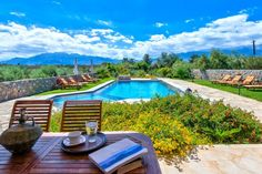 """Villa Litsarda is a luxury, """"green"""" Villa with a private swimming pool of 70 sq m. It is located in the tranquil village of Litsarda, 2 km f. Villa With Private Pool, Greece Holiday, Colorful Garden, Luxury Villa, Crete, Holiday Fun, Swimming Pools, Beach, Places"""