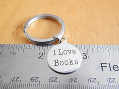 I Love Books keychain - 20mm round - Book Jewelry, Gift for Student, Gift Under 20 par FamilyHouseStampin sur Etsy https://www.etsy.com/ca-fr/listing/466425526/i-love-books-keychain-20mm-round-book