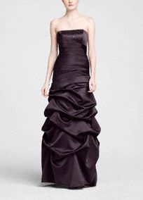 Rich in detail and style, this satin gown is great for a more formal wedding or event.  Strapless bodice features elegant beading along the neckline for a touch of sparkle.  Side ruching creates a slimming effect to hide any flaws.  Floor-length pick-up skirt enhancesthe drama of this already glamorous gown.  Fully lined. Back zip. Dry clean only.