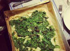 Popeye pie - pizza crust, spinach, garlic, pecorino, and mozzarella