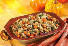 A colorful array of spinach, carrots, mushroom, onion and water chestnuts add new personality to herb-seasoned stuffing moistened with savory vegetable broth.