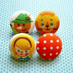 Fairytale cloth covered buttons. I might sew something with materials this adorable.
