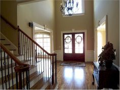 Would love our foyer to resemble this one day after we replace the ugly brass chandelier and tile. So gorgeous!