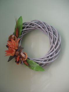 Decorative wreath with cinnamon and orange flowers