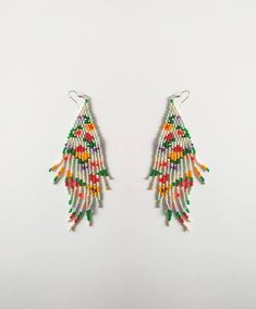 Simple and beautiful hand beaded earrings. Item will be shipped in 1-3 days after the purchace with Registered Priority Mail Worldwide. ----------------- Custom orders are welcome - other colors, forms, patterns etc. Feel free to contact me