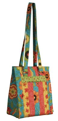 This bag has 4 pockets, and the pattern is downloadable. If this doesn't get me to plug in my sewing machine, nothing will!