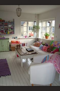 Love the contrast in colours against the white, & coffee table