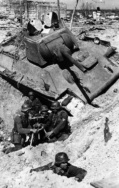 German 81mm mortar with crew and a destroyed T-34.Stalingrad.