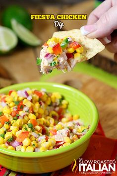 Fiesta Chicken Dip is a simple layered dip featuring creamy salsa chicken that is topped with a fresh corn salsa. It is bursting with flavor and this recipe is so easy to put together. This scoopable party dip is sure to be the star of the show. A great way to use up left over chicken!