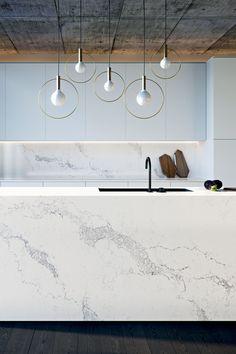 Marble+concrete+wood+brass in this sleek kitchen. Brilliant!