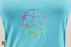 On Sale Turquoise razor back yoga shirt with embroidered lotus mandala design. Originally by Champion. Tags still on. $20.99 USD.  pict 2