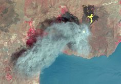 Nasa has made nearly three million images of Earth's thermal emissions available to the public for free, such as this image taken in March. It shows the eruption of Nicaragua's Momotombo volcano with its visible and thermal infrared bands. The ash plume is depicted by the visible bands in blue-gray; the thermal infrared bands show hot lava flows in yellow and the active summit crater in white. Vegetation is red