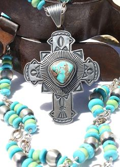 Navajo cross necklace - western jewelry, turquoise cross, pilot mountain turquoise, western jewels http://www.cowgirlkim.com/unique-silver-creations-sterling-necklace-and-turquoise-cross-pendant.html