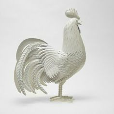The rooster has intricate artistic detailing with an antique handicraft look and is built to last. It will look fabulous in your kitchen or living room - even use it as a stunning centerpiece decoration on your table.