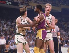 Larry Bird intervenes as an angry Magic Johnson has words with Danny Ainge during Game 2 of the 1985 NBA Finals.