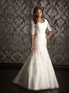 Lovely lace wedding dress with 3/4 sleeves Allure Bridals: Style: M490