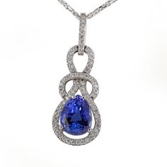 18kt white gold pendant with a 6.48ct pear shaped tanzanite surrounded by a knot of diamond accents totaling 0.75ctw. LCP11576. #jewelry #tanzanite
