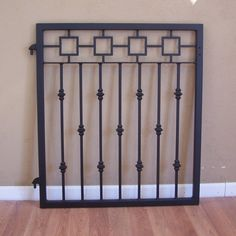 Ornamental Iron garden gate with a decorative metal Greek Frieze pattern and cast iron collars. This steel and cast iron gate is built with simple but elegant classical lines. Featuring a decorative frieze element on the top and cast iron collars on the pickets. Made to fit an