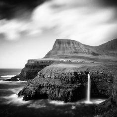 Faroe Islands, Gasadalur village in long exposure black and white