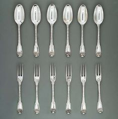 A set of six George II silver dessert-spoons and twelve dessert-forks | MARK OF PAUL DE LAMERIE, SOME OVERSTRUCK BY THAT OF JAMES SHRUDER, LONDON, CIRCA 1740 | Christie's