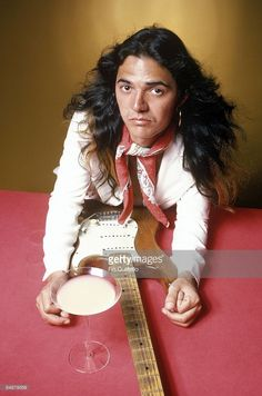 Photo of DEEP PURPLE and Tommy BOLIN; Tommy Bolin, posed with guitar and cocktail