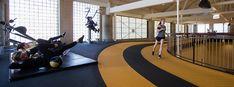 Indoor track overlooking gymnasium with workout equipment