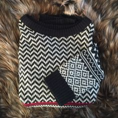 Black and White Patterned Sweater Confess for Macy's. Worn once for a Christmas party! The line is kinda red but kinda pink looking. So soft & flattering!    I'll trade for a CHANEL gift card worth $8,000, a Jeep Wrangler Sport Ultimate, or a MacBook Air. Macy's Sweaters