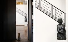 Graphic iron stair rail in a Paris apartment. Interior design by the Brussels based Anne Derasse.