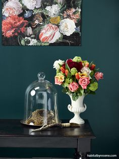 With dark and moody colours on the walls, bring a burst of colour through artwork and flowers. The walls are painted in Resene Atlas. The wallpaper, used as artwork in this living room, is from the Eijffinger Masterpiece 358000 available from Resene ColorShops. Photo by Melanie Jenkins. Styling by Megan Harrison-Turner.