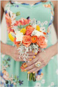love this peach, coral, and aqua combination of bridesmaid gown and bouquet. Especially love the silvery sage-y bits