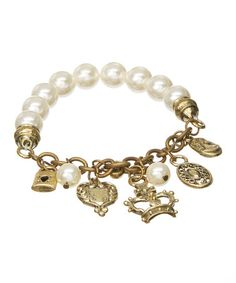 Loving this White Faux Pearl & Goldtone Charm Stretch Bracelet on #zulily! #zulilyfinds