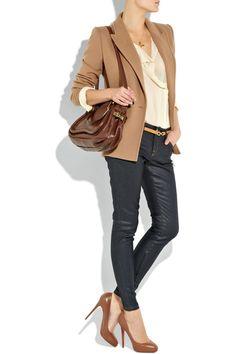 tan jacket. tan heels. cream shirt. brown bag. black pants