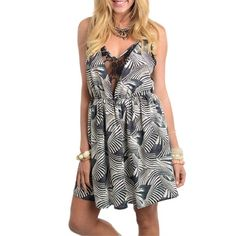 NWOT Printed Spaghetti Strap Mini Dress Brand new. This dress features sheer lace details and a truly unique print. Dresses