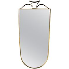 Brass Milanese Mirror  Italy  1940s  Elegant brass Italian mirror made in Milan circa 1940 in a stylized shield shape which was popular in lombardian design.