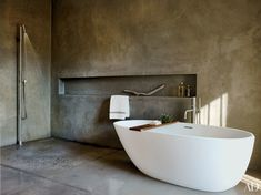 In a Hudson Valley, New York, bath by architect Basil Walter, the troweled-concrete master bath has a Wetstyle tub with Boffi fittings.