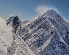 Just looking at this photo makes us gasp for air. Team athlete @renan_ozturk chases Migma Sherpa high in the Langtang Himlaya, Nepal.