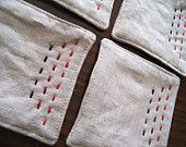 Hand-stitched linen coasters - red, burgundy, and brown - set of 4