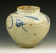 White pottery jar, Korea, 18th or 19th century, with large blue tendril motifs