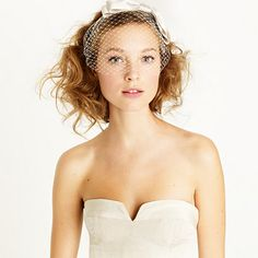 Twirl short strands about a curling iron, then tousle with texturizing spray for this cute 'do.