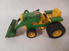 "Up for Sale is the Tonka ""Toy Tractor w/ Loader"" Pressed Steel & Plastic. The size is 6""L x 2""H x 3""W. The tractor is dirty and the tractor is worn from play wear and the load part of the tractor is rusty in some parts.  (see pictures)."