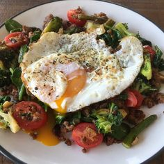 """""""Breakfast # 2.  Because I made extra crispy waffles for everyone else and may have accidentally made sure they were safe for me to eat too . It's the simple pleasures in life.  # This beautiful plate has Grassfed taco meat, spinach, grape tomatoes, broccoli and asparagus with a pastured egg fried in ghee on top. #paleo #paleohope #paleobreakfast #breakfast #cleaneating #eatrealfood #eatforhealth #eatyourgreens #eatyourveggies #eatbreakfast #breakfastisforwinners #fitfood #freerangeeggs"""