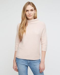 Versatile sweater with horizontal-rib detail carefully crafted in extra-fine merino wool with a brush of cashmere. Roll neck, relaxed fit through the body and elbow length sleeves. Team with Jigsaw skinny-fit denim or midi skirts for effortless style.