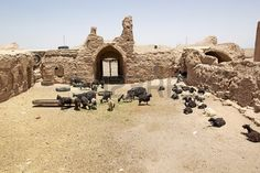 Ruins of the historic caravanserai along the road from Meybod to Nain Iran now used as animal husban Stock Photo